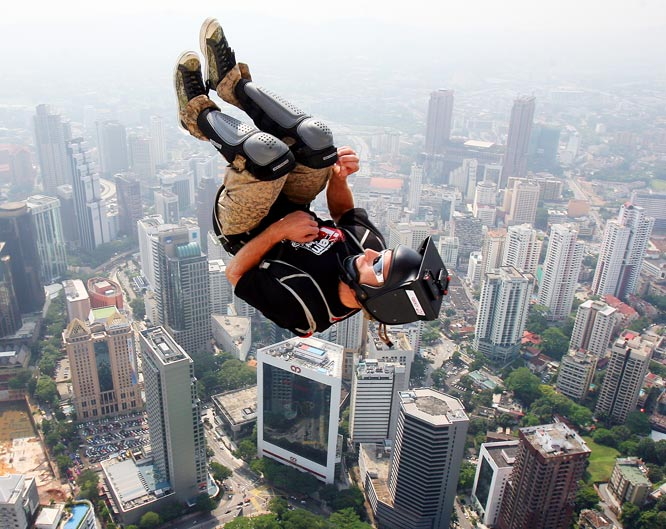 Paul Morton of New Zealand performs an acrobatic dive as he leaps from the top of the 421-metre Kuala Lumpur Tower during the International Tower Jump in Malaysia on Oct. 23. Eighty-two professional base jumpers from 18 countries took part in the annual event.