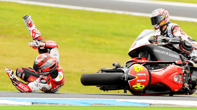 Alvaro Bautista of Spain rolls on the track after crashing during the warmup session for the Australian 250cc Motorcycle Grand Prix at Phillip Island on Oct. 18. Bautista finished 10th at the event.