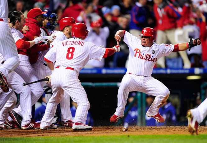 Philadelphia's Carlos Ruiz (right) celebrates after scoring the winning run in the ninth inning of Game 4 of the NLCS.