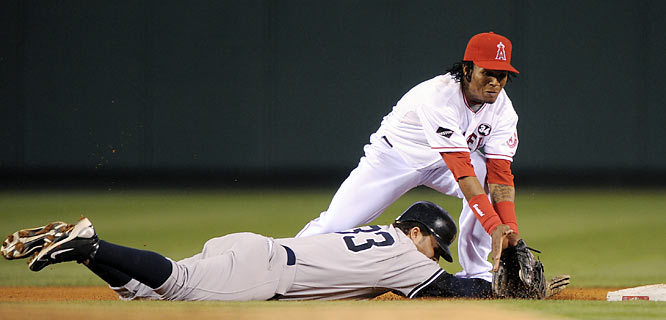 Los Angeles Angels' Erick Aybar appears to tag out New York Yankees' Nick Swisher as he slides back to second on a pick off attempt, but he was called safe.