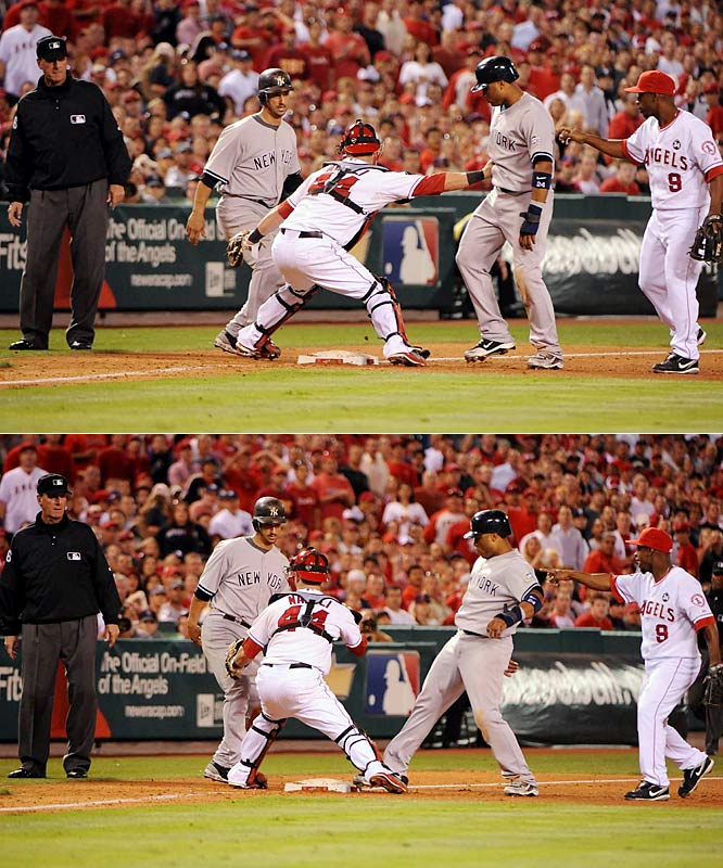 Yankees Jorge Posada and Robinson Cano were caught off third base in the fifth inning of Game 4 of the ALCS, and both appeared to be tagged out, but third base umpire Tim McClelland ruled Cano safe. The mistake did not lead to any scoring in the inning, however.