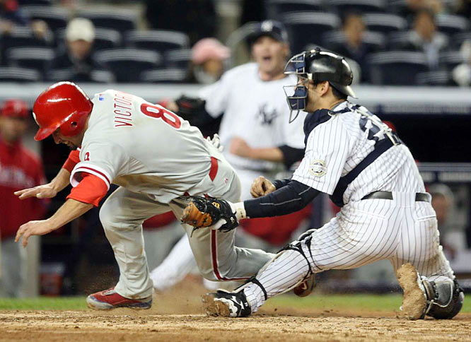 Shane Victorino was tagged out by Jorge Posada to end the ninth inning.