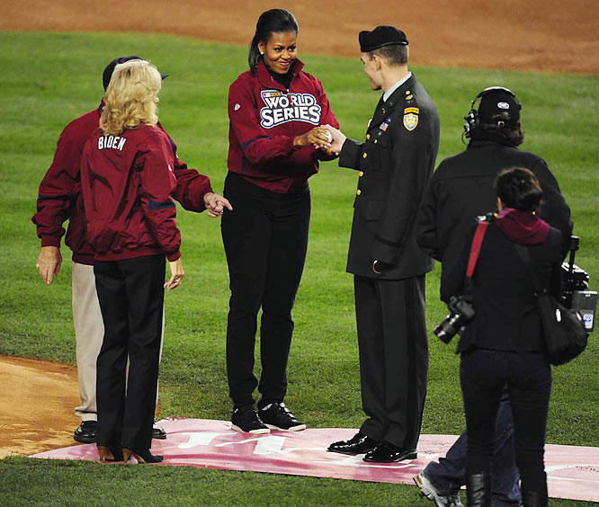 Hall of Famer Yogi Berra, first lady Michelle Obama and Dr. Jill Biden present Iraq veteran Tony Odierno with a baseball so he can throw out the ceremonial first pitch before Game 1.