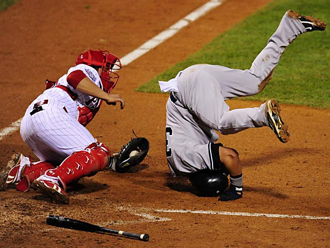 Nick Swisher got a shove from catcher Carlos Ruiz after scoring in the fifth.