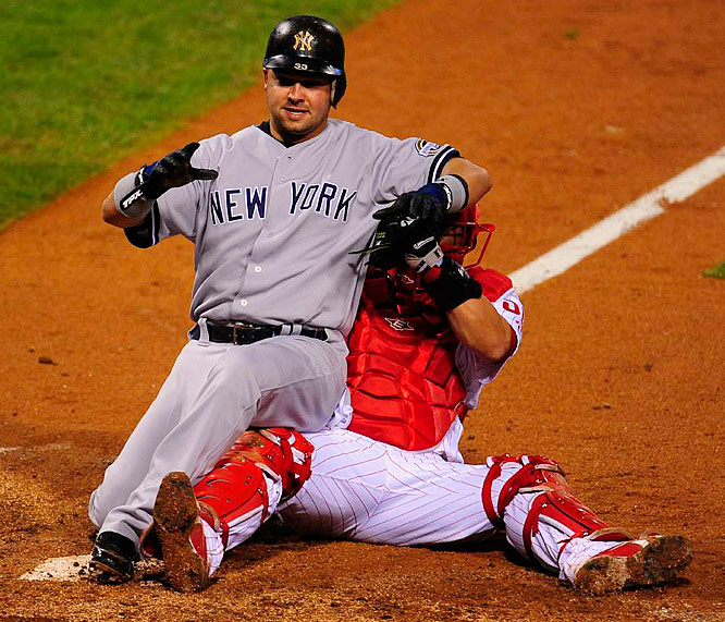 Nick Swisher slides in safely before the tag to tie the game at 3-3 in the fifth. The Yankees went on to score two more runs in the inning.