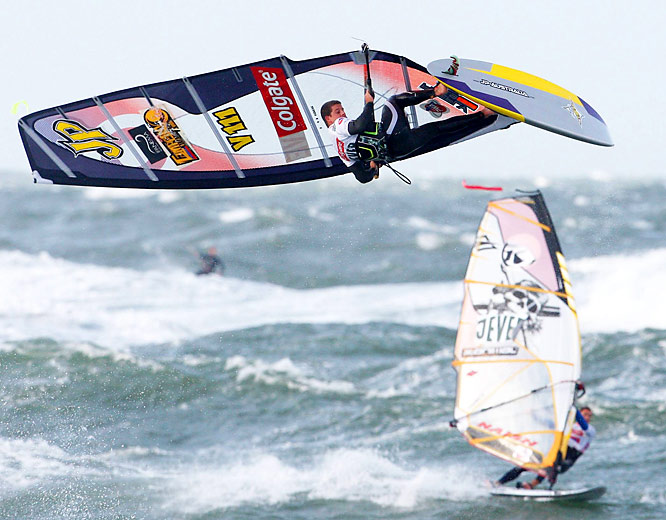 Venezuela'S Ricardo Campello soars above other competitors as he rides the waves at the 26th Windsurfing World Cup off Westerland, Germany, on Oct. 1.