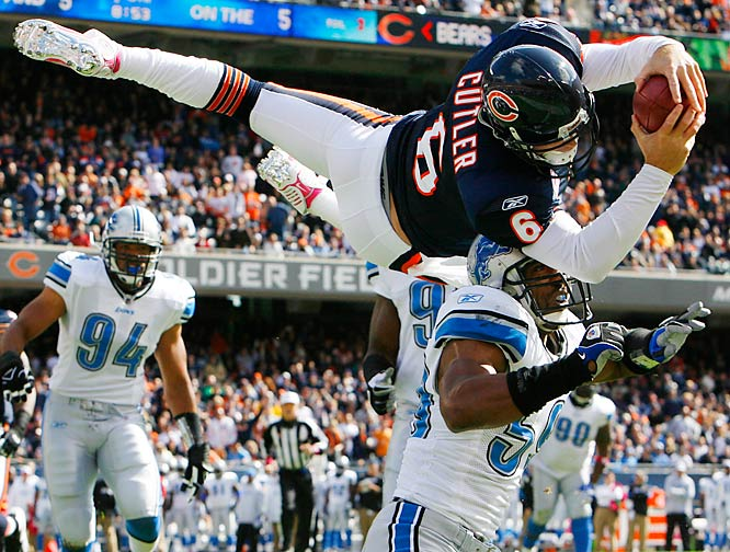 Chicago Bears quarterback Jay Cutler dives over Detroit Lions linebacker Julian Peterson for a touchdown during the Bears 48-24 victory on Oct. 4.