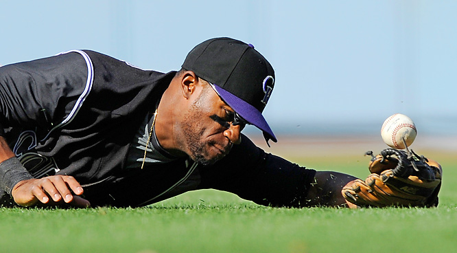 Colorado second baseman Eric Young Jr. cannot hold on to a ball hit by Los Angeles Dodgers' Doug Mientkiewicz during the seventh inning of their game on Oct. 4 in L.A. The Dodgers defeated the Rockies 5-3.