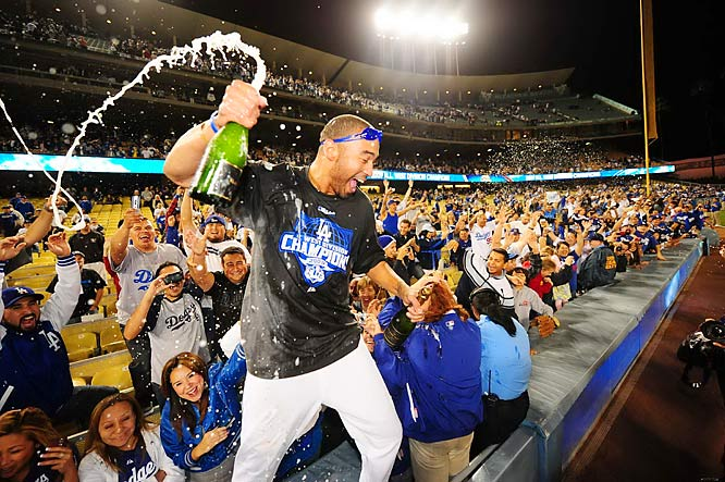 Los Angeles Dodgers Matt Kemp celebrates with fans after L.A. won the National League West title by defeating the Rockies 5-0 on Oct. 3.