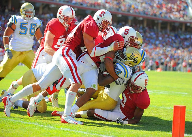 Running back Johnathan Franklin of UCLA is gang tackled short of the goal line by the Stanford defense on Oct. 3. Stanford won 24-16.