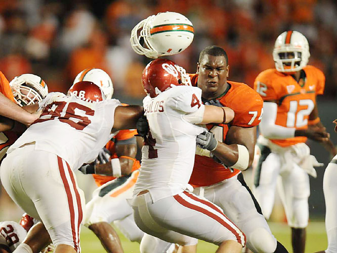 Offensive lineman Orlando Franklin of Miami loses his helmet while blocking against Oklahoma. The Hurricanes beat the Sooners 21-20 at LandShark Stadium in Miami on Oct. 3