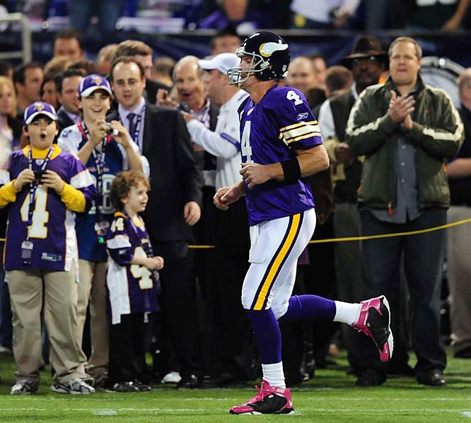 Brett Favre has had quite an emotional two games, beating the San Francisco 49ers on a last-second pass, followed by a stirring victory over his former club, the Green Bay Packers. Here are some Outside the Huddle shots of Favre from those games. And, yeah, his Breast Cancer Awareness sneakers were a hit with the kids.
