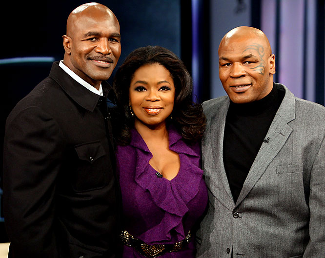 The only thing odder than watching Tyson bite off a piece of Holyfield's ear 12 years ago was seeing the two old fighters sitting on either side of Oprah Winfrey during her show last Friday. While Holyfield still looks like he could compete for the heavyweight title, Tyson seems to be going for another kind of heavyweight crown.