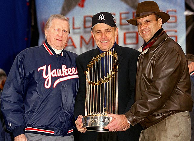 Steinbrenner, New York City mayor Rudy Giuliani and Yankee manager Joe Torre with the trophy following the Yankees 2000 World Series title.