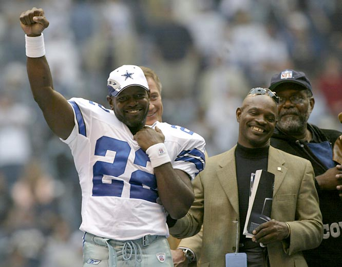 Dallas RB Emmitt Smith (pictured here with Eddie Payton) rushes for 109 yards to surpass Walter Payton as the NFL's all-tme rushing leader. Smith finishes the 2002 season with 17,162 rushing yards.