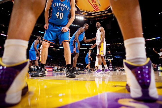 Guard Sasha Vujacic of the Lakers prepares to pass to DJ Mbenga (40) as Ryan Bowen of the Oklahoma City Thunder defends the inbound pass during L.A.'s 101-85 victory over the Thunder on Nov. 22.