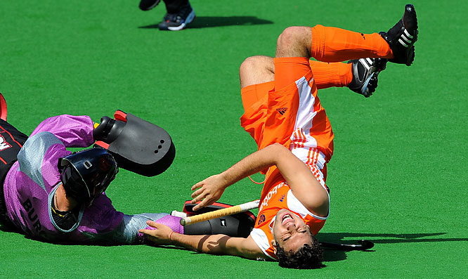 Valentin Verga of the Netherlands (right) crashes over Australia goalkeeper Nathan Burgers during their Champions Trophy field hockey match in Melbourne on Nov. 29.  Australia defeated the Netherlands 7-2.  <br><br>Send comments to siwriters@simail.com