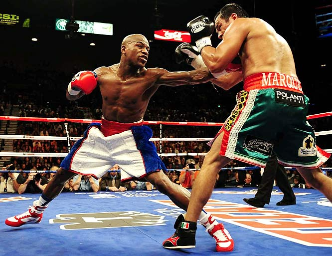 "After a 21-month retirement, Mayweather returned to face Marquez, at a catch-weight of 144 pounds. The time off hardly seemed to affect the 32-year-old Mayweather, who pummeled Marquez -- ""Money"" landed 59 percent of his punches for a unanimous-decision victory, while Marquez only landed 12 percent."