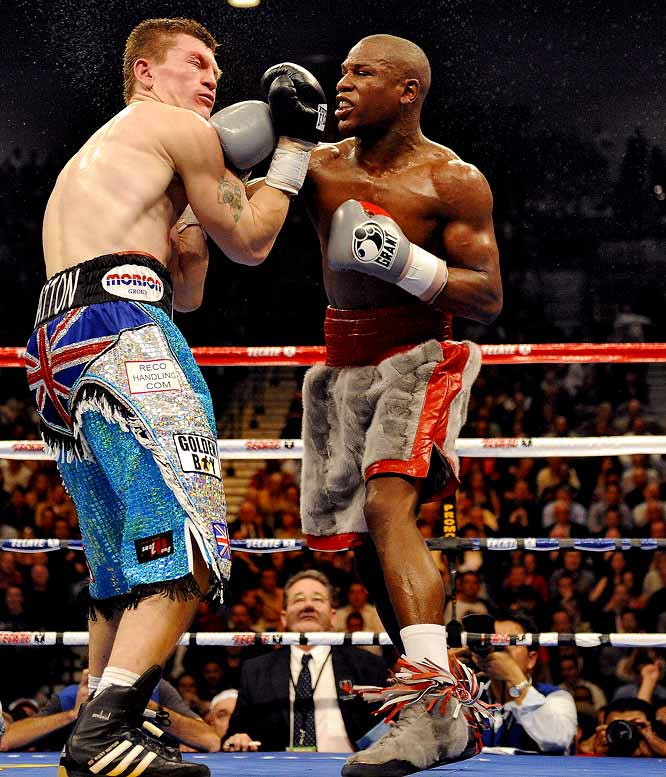 "Mayweather put his WBC welterweight title and flawless record on the line as he took on then-undefeated Ricky Hatton in Las Vegas. Hatton, the light welterweight champion, managed to give Mayweather a challenge early on, and even Floyd admitted Hatton was ""one of the toughest competitors I've faced."" Still, Mayweather peppered the British brawler with punches until the referee stopped the fight in the 10th round."