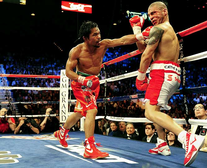 This was hyped as the fight of the year, and it didn't disappoint. Cotto showed his aggression and strength in the opening rounds, but Pacquiao's dynamic (and relentless) punches, speed and power left the Puerto Rican welterweight champion bloodied and bruised midway through the bout. Cotto remained courageous throughout, but the referee ended the beating in the 12th round, giving Pacquiao his seventh world title in as many weight classes.