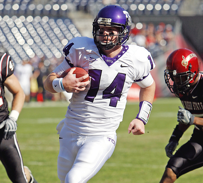 Andy Dalton (center) threw two touchdown passes and ran for two more as TCU won its 11th straight to remain in the chase for a BCS bowl berth. The Horned Frogs ' defense, ranked first in the country in total defense, produced four turnovers that led to 13 points.