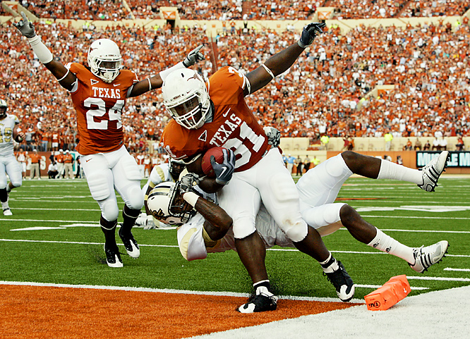 Cody Johnson tumbles into the end zone for his second touchdown as Texas shook off a slow start. Jordan Shipley set a UT record with 273 yards receiving, including an 88-yard touchdown, and Colt McCoy threw for 470 yards -- just short of running backs coach Major Applewhite's school-record 473 yards in the 2001 Holiday Bowl.