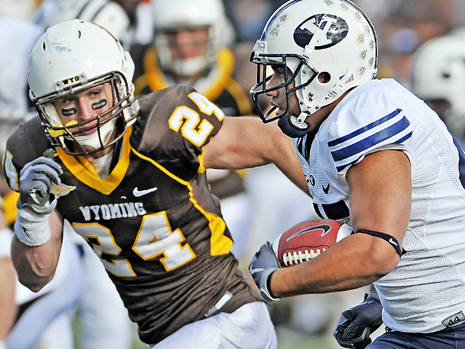 Harvey Unga (right) rushed for 85 yards and two scores as Brigham Young handed Wyoming its most lopsided loss since 1985.  Max Hall threw for 312 yards and four touchdowns in just over two quarters as the Cougars won their sixth straight over the Cowboys.