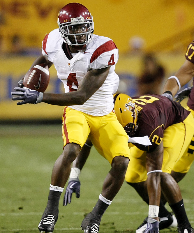 Joe McKnight (left) and Allen Bradford combined for 145 yards to help Southern California rebound from the worst loss in the Pete Carroll era. The victory kept the Trojans in the hunt for an eighth straight Bowl Championship Series berth. Will Harris returned an interception 55 yards for a score, Matt Barkley threw a 75-yard pass to Damian Williams for another score to account for the Trojans' scoring.