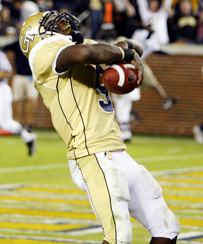 Josh Nesbitt scored the game-winner in overtime to power the Yellow Jackets, who converted a gutsy fourth-down gamble to escape the Demon Deacons' upset bid. Georgia Tech would clinch a spot in the ACC title game with a win at Duke next Saturday.