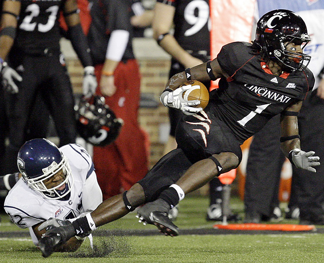 Mardy Gilyard (right) caught 12 passes for 172 yards as Cincinnati matched the best start in its history. Zach Collaros threw for 480 yards and a touchdown as the 9-0 Bearcats kept themselves in the conversation of national title contenders. Sophomore Jordan Todman rushed for 162 yards and four touchdowns for the 4-5 Huskies.