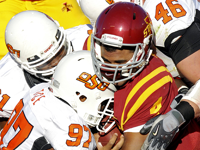 Ugo Chinasa (No. 91) and Jeremiah Price (No. 97) led a strong defensive effort as Oklahoma State limited Iowa State to 54 rushing yards and 13 first downs. Senior Keith Toston rushed for 207 yards and three touchdowns for the Cowboys, who next host Texas Tech and Colorado.