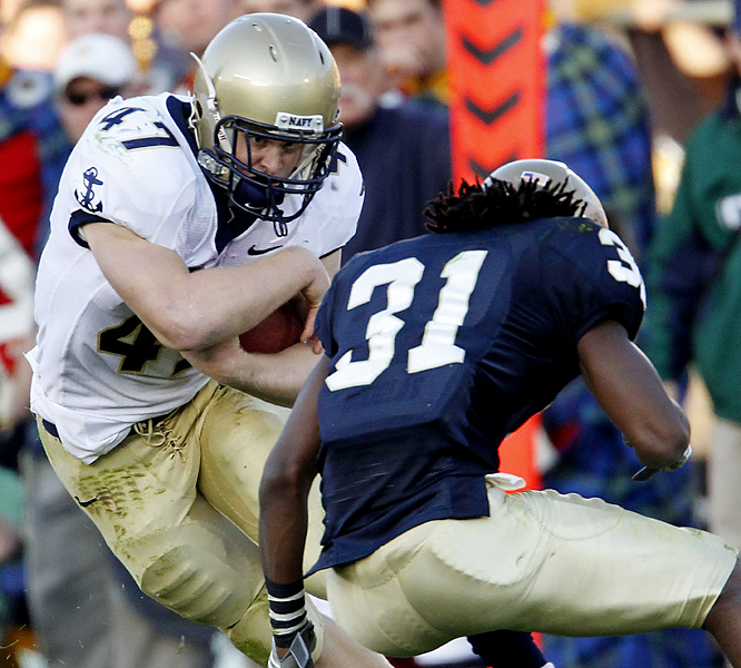 Vince Murray (left) rushed for 158 yards and a touchdown as Navy improved to 7-3 by stunning the Fighting Irish for the second straight time at Notre Dame Stadium. Jimmy Clausen threw for 453 yards and two scores, but Notre Dame (6-3) effectively lost any hope for a Bowl Championship Series berth.