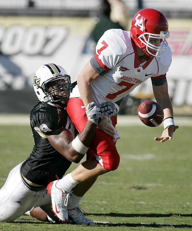 Central Florida not only found a way to slow down Case Keenum (right), the Knights didn't give the nation's most prolific passer a chance to pull off another improbable comeback. Jarvis Geathers (left) forced one of three fumbles to help stymie Keenum, who had kept alive Houston's five-game winning streak with a pair of last-minute rallies.