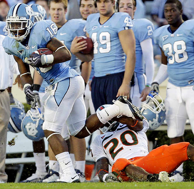 Kendric Burney (left) returned one of his three interceptions for a 77-yard touchdown and his third pick resulted in a bizarre fourth-quarter score that helped North Carolina improve to 7-3 overall and 3-3 in the ACC. The Tar Heels became bowl eligible for the second straight year and gave Butch Davis yet another win against his former program. It also was North Carolina's fifth consecutive win against ranked teams dating to last season.