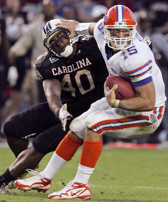 Tim Tebow tied the Southeastern Conference touchdown record and Florida gained its first perfect league season in 13 years with a tough road win. The Gators (10-0 overall, 8-0 in the SEC) -- who again called on their conference-leading defense -- remained on track for a third national title in four years. Tebow's fourth-quarter touchdown, a 1-yard burst, was the 53rd of his SEC career and matched LSU's Kevin Faulk.