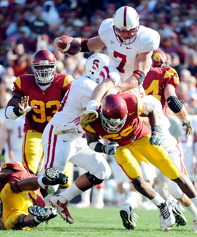 Toby Gerhart (top) rushed for 178 yards and three touchdowns and Stanford (7-3, 6-2) emphatically followed up its 2007 upset at the Coliseum by beating USC (7-3, 4-3), the most points ever allowed by the Trojans. The loss was the Trojans' worst since a 51-0 defeat at home against Notre Dame in 1966 and essentially ended USC's seven-year run as Pac-10 champions.