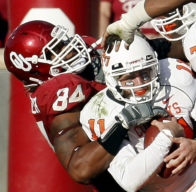 Frank Alexander (left) and the Sooners limited the Cowboys to six first downs and 109 total yards. Oklahoma State (9-3, 6-2) was shut out for the first time since 2005 by an Oklahoma (7-5, 5-3) defense coming off its worst outing of the year in a loss at Texas Tech last week. The Sooners have won seven in a row in the Bedlam rivalry and 30 straight home games, the longest streak in the Bowl Subdivision.