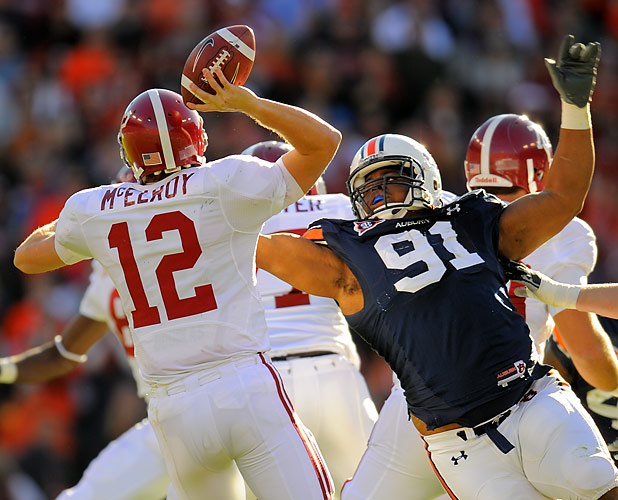 Jake Ricks (91) and Auburn sacked Alabama quarterback Greg McElroy three times but couldn't prevent him from throwing a pair of TD passes in the Tide's 26-21 victory.