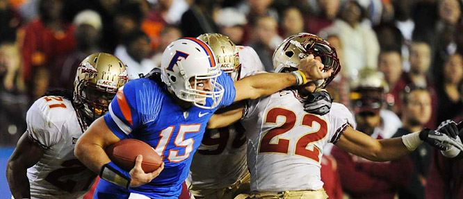 Florida quarterback Tim Tebow (15) passed for 221 yards and three touchdowns and ran 15 times for 90 yards and two more scores in a 37-10 win over Florida State. Along the way he fended off cornerback Korey Mangum with a nice straightarm.