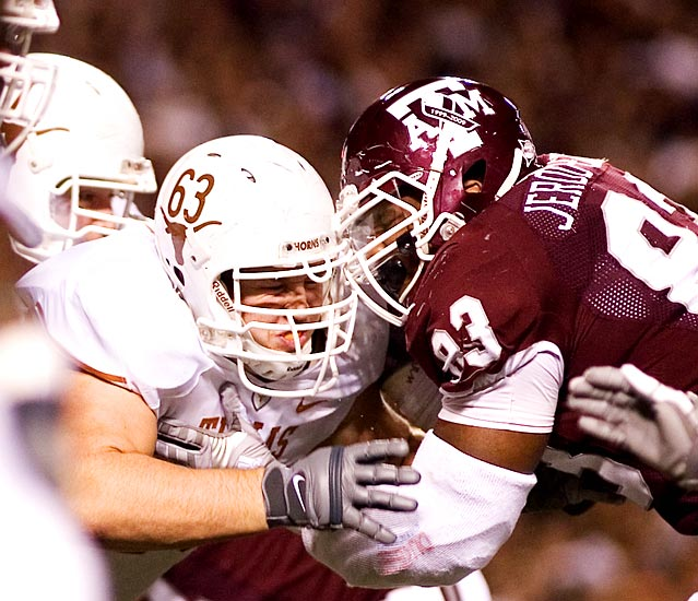 Texas A&M and Texas locked horns on Thanksgiving Day, with guard Michael Huey (63) and Tony Jerod-Eddie (83) battling in the trenches throughout a game won 49-39 by Texas.