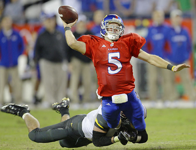 Kansas quarterback Todd Reesing is tackled by  linebacker Andrew Gachkar during a two-point loss to Kansas. Reesing was called for grounding on the play.