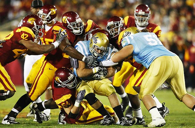 Linebacker Chris Galippo (54) and the USC defense helped the Trojans win the 79th meeting between the crosstown rivals, 28-7.