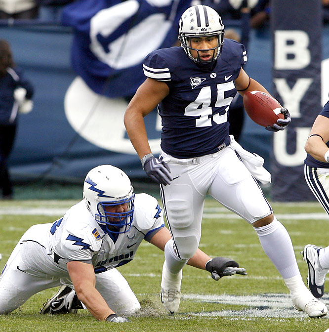 Max Hall threw for five touchdowns and set a BYU record with his 30th career win. Harvey Unga (left) became BYU's all-time rushing leader with 67 yards, giving him 3,268 in his career.