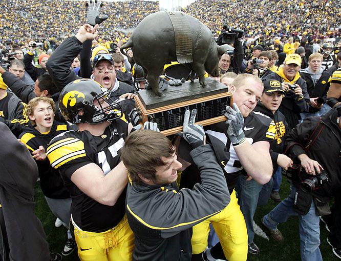 With a bronze pig on the line, No. 15 Iowa put a new twist on winning ugly -- this time by taking a game that featured more punts than points. The victory gave the Hawkeyes double-digit victories for the first time since 2004, along with Floyd of Rosedale - the pig trophy awarded to the winner of the border rivalry.