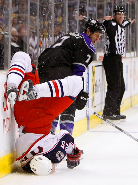 Jason Chimera of Columbus gets checked by Rob Scuderi of L.A. at the Staples Center on Oct. 25. The Kings won 6-2.