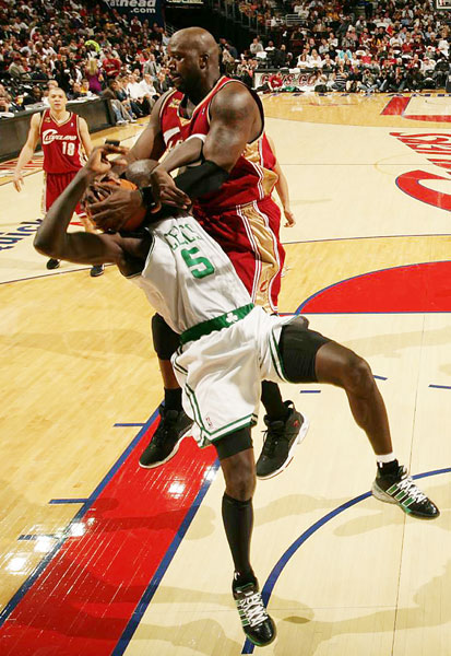 Shaquille O'Neal of the Cleveland Cavaliers fouls Kevin Garnett of the Boston Celtics during the season opener on Oct. 27. Garnett had 13 points as the Celtics won 95-89.