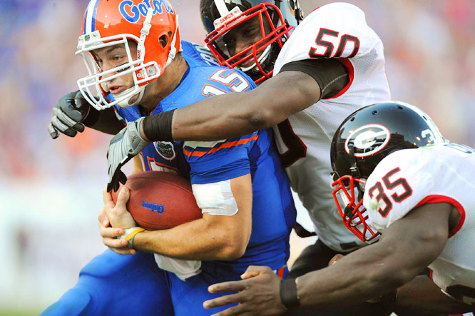 Florida's Tim Tebow struggles for yardage as Georgia linebackers Darryl Gamble and Rennie Curran make the tackle at Municipal Stadium in Jacksonville on Oct. 31. Florida defeated Georgia 41-17.