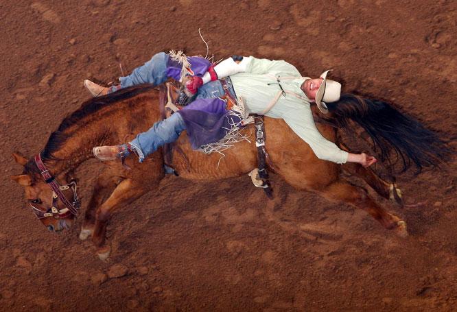 Brian Bain competes in bareback riding at the World's Toughest Rodeo on Nov. 6, in Glendale, Ariz.