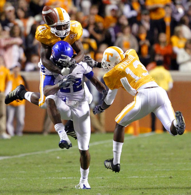 Tennessee's Dennis Rogan and Brent Vinson break up a pass intended for Memphis' Dale Calhoun during the Vols' 56-28 win on Nov. 7.