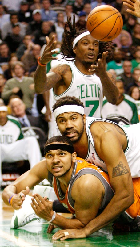 Boston guard Marquis Daniels grabs a loose ball as teammate Rasheed Wallace lands atop Phoenix forward Jared Dudley during a 110-103 win on Nov. 6.